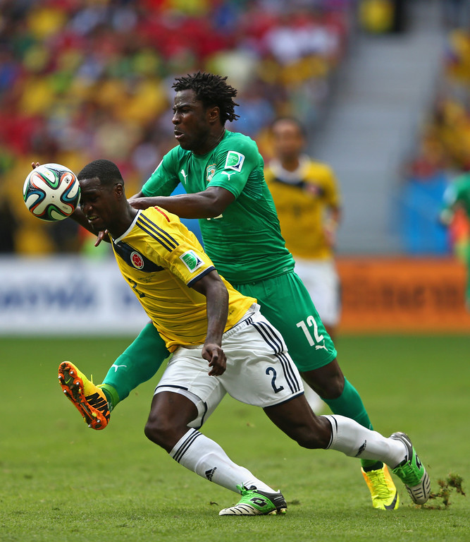 . Wilfried Bony of the Ivory Coast and Cristian Zapata of Colombia compete for the ball during the 2014 FIFA World Cup Brazil Group C match between Colombia and Cote D\'Ivoire at Estadio Nacional on June 19, 2014 in Brasilia, Brazil.  (Photo by Warren Little/Getty Images)