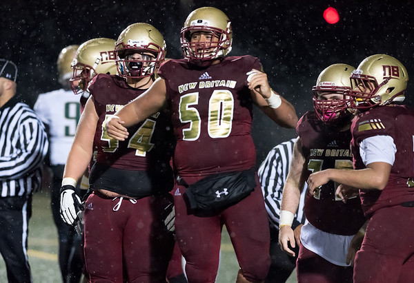 11/09/18 Wesley Bunnell | Staff New Britain vs Enfield at Veterans Stadium on Friday night. Brandon Rivera (50) celebrates with teammates after recovering a New Britain fumble in the end zone for a touch down.