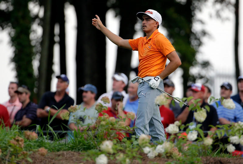 . Rickie Fowler watches his tee shot on the 14th hole during the final round of the PGA Championship golf tournament at Valhalla Golf Club on Sunday, Aug. 10, 2014, in Louisville, Ky. (AP Photo/Jeff Roberson)