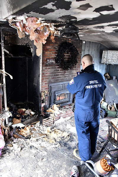 1/10/2020 Mike Orazzi   Staff Acting Bristol Fire Marshal David VanWie while investigating a fire on Clearview Avenue in Bristol. The home was rendered uninhabitable displacing two adults, a baby and four pets.