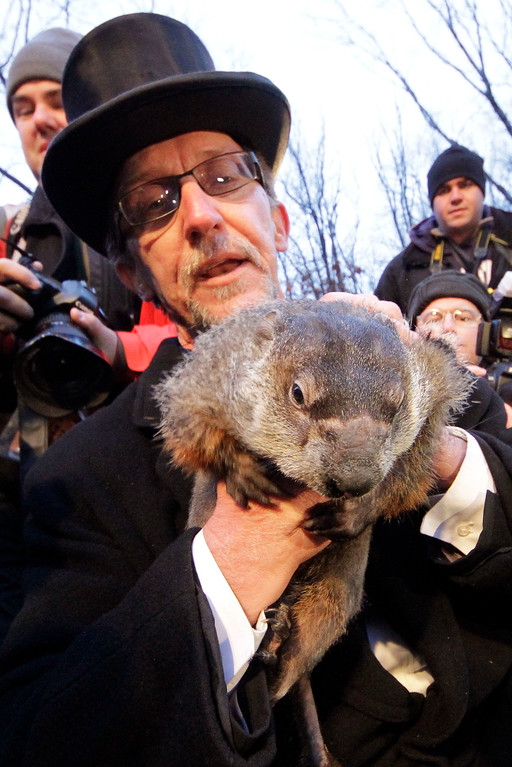. Groundhog Club handler Ron Ploucha holds Punxsutawney Phil, the weather prognosticating groundhog, during the 126th celebration of Groundhog Day on Gobbler\'s Knob in Punxsutawney, Pa. Thursday, Feb. 2, 2012. Phil saw his shadow, forecasting six more weeks of winter weather. (AP Photo/Gene J. Puskar)