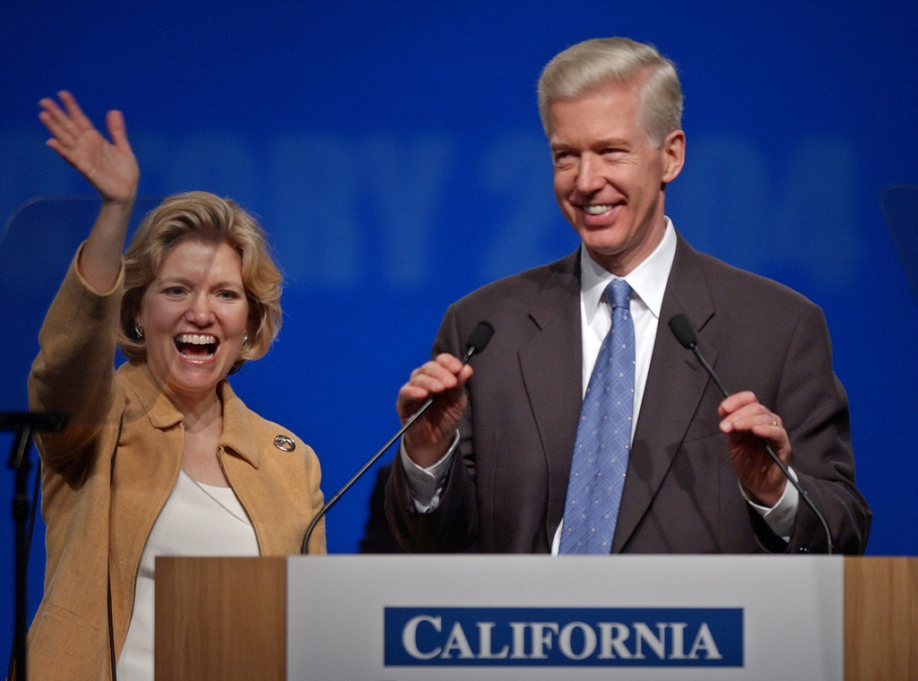 . Former California Gov. Gray Davis, right, as his wife, Sharon, waves before his speech at the California Democratic State Convention in San Jose, Calif., Saturday, Jan. 17, 2004. (AP Photo/Paul Sakuma)