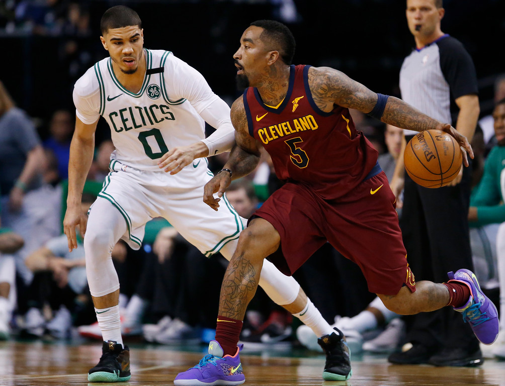 . Cleveland Cavaliers guard JR Smith (5) drives on Boston Celtics forward Jayson Tatum (0) during the third quarter of Game 1 of the NBA basketball Eastern Conference Finals, Sunday, May 13, 2018, in Boston. (AP Photo/Michael Dwyer)