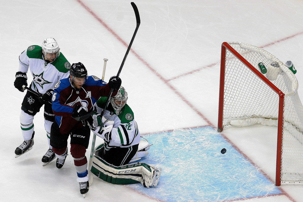 . Dallas Stars goalie Kari Lehtonen (32) watches as a goal scored by Colorado Avalanche left wing Gabriel Landeskog (92) crosses the line, while Colorado Avalanche center Paul Stastny (26) and Dallas Stars defenseman Brenden Dillon (4) look on during the second period of action. (Photo by AAron Ontiveroz/The Denver Post)