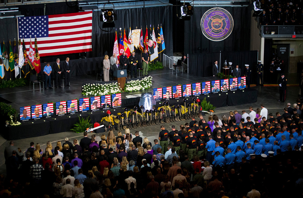 . Pastor Ron Merrell leads a prayer during a memorial service for the 19 fallen firefighters at Tim\'s Toyota Center in Prescott Valley, Ariz. on Tuesday, July 9, 2013.  (AP Photo/The Arizona Republic, Michael Chow, Pool)