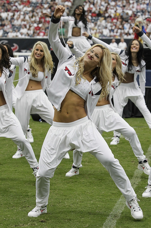 . Houston Texans cheerleaders perform to the music  Vanilla Ice at the halftime between the Tennessee Titans and Houston Texans at Reliant Stadium on September 15, 2013 in Houston, Texas.  (Photo by Bob Levey/Getty Images)
