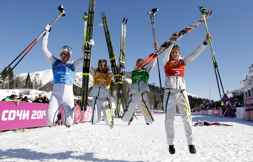 . Sweden\'s women\'s 4x5K cross-country relay team Ida Ingemarsdotter, Emma Wiken, Anna Haag and Charlotte Kalla, from right, celebrate winning the gold after the women\'s 4x5K cross-country relay at the 2014 Winter Olympics, Saturday, Feb. 15, 2014, in Krasnaya Polyana, Russia. (AP Photo/Kirsty Wigglesworth)