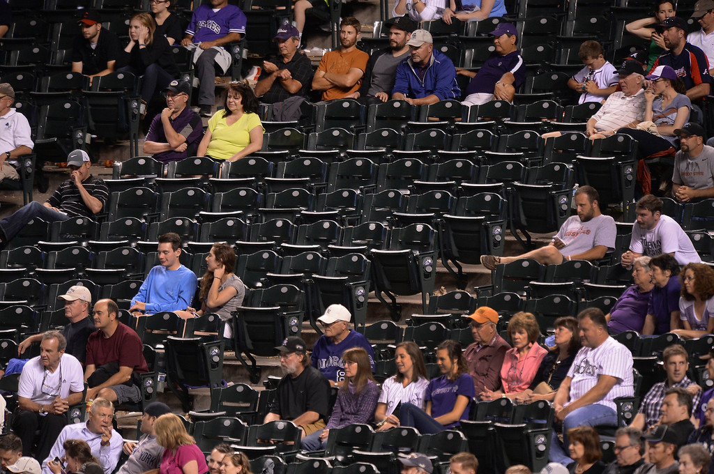 . The Rockies\' recent skid has resulted in fewer fans coming to the ballpark. The Atlanta Braves defeated the Colorado Rockies 13-10 Tuesday night, June 10, 2014. (Photo by Karl Gehring/The Denver Post)