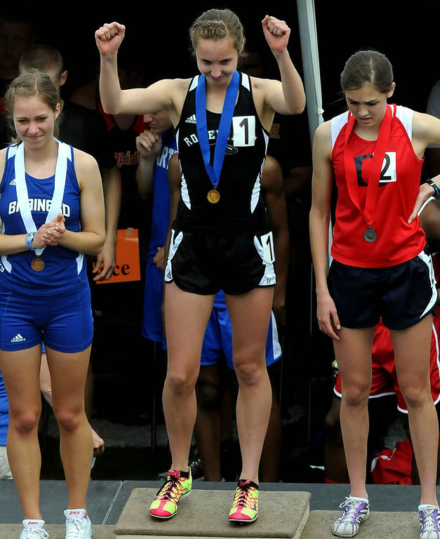 . Roseville\'s Samantha Nielsen, middle, reacts after getting her first-place medal in the 800 meter run with a time of 2:13.33. Brainerd\'s Allison Kosobud, left was third and Orono\'s Stephanie Knight, right, was second.  (Pioneer Press: Sherri LaRose-Chiglo)