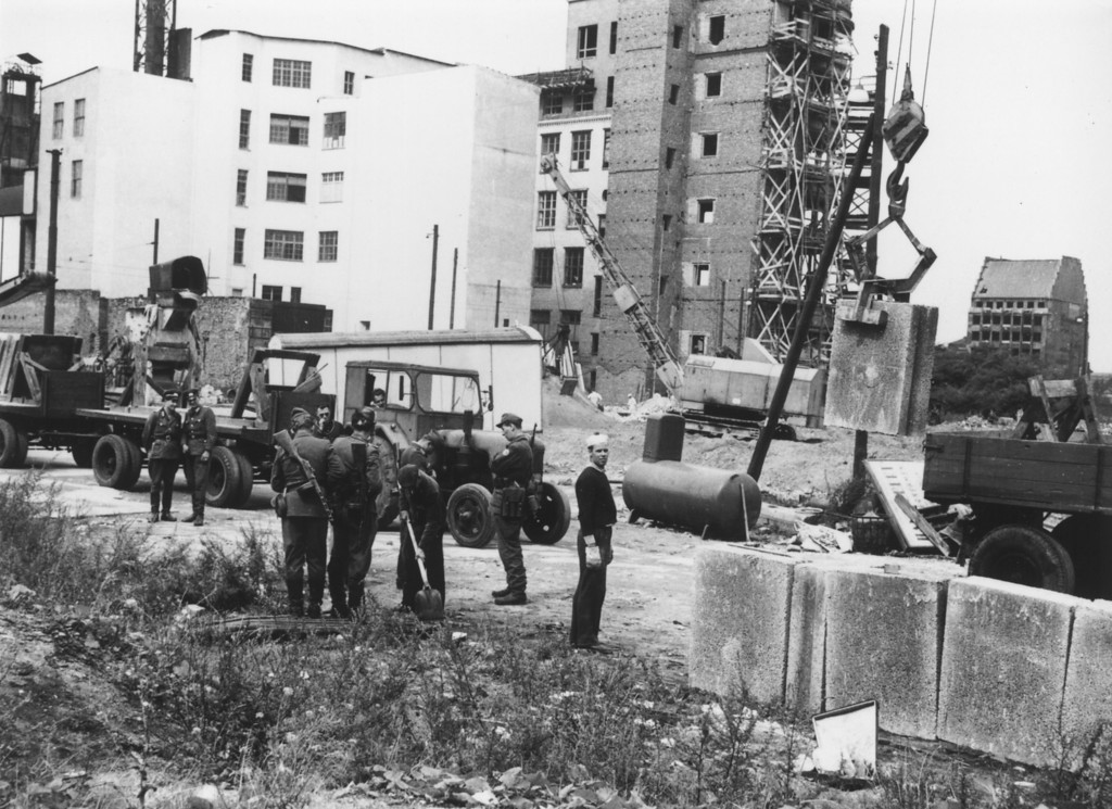 . East German military personnel supervising construction of the Berlin Wall in August 1961.  (Photo by Central Press/Getty Images)