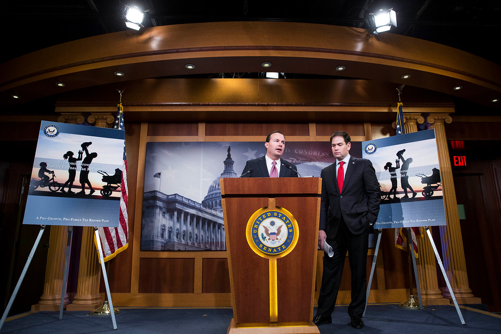 . Sen. Mike Lee (R-Utah) (L) speaks next to Sen. Marco Rubio (R-FL) during a news conference to introduce their proposal for an overhaul of the tax code, March 4, 2015 on Capitol Hill in Washington, DC.  (Photo by Drew Angerer/Getty Images)