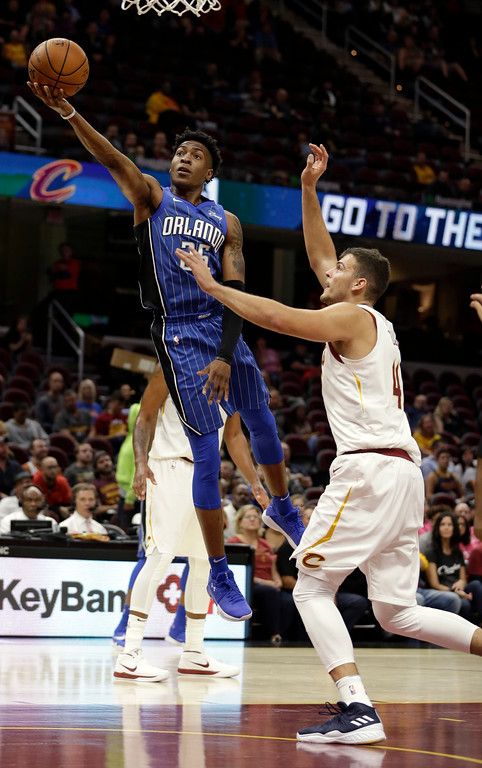 . Orlando Magic\'s Wesley Iwundu, left, shoots against Cleveland Cavaliers\' Ante Zizic (41), from Croatia, in the second half of an NBA basketball game, Saturday, Oct. 21, 2017, in Cleveland. (AP Photo/Tony Dejak)