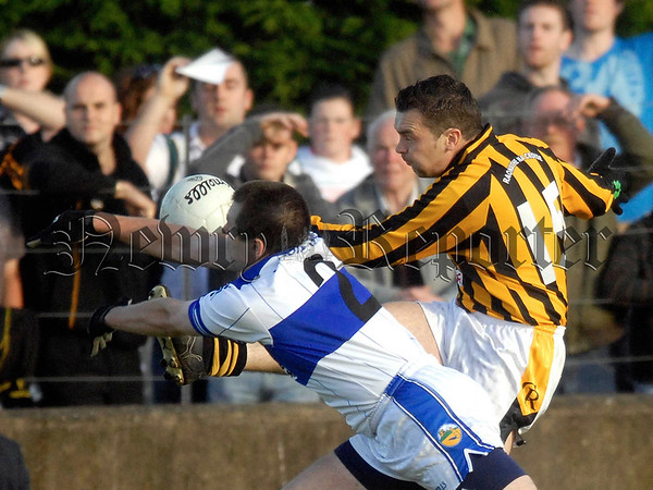 07W34N253 Armagh Senior Championship 2007 Second Round Crossmaglen Rangers v St Patricks Dromintee at Keeley Park Silverbridge. Dromintee's Michael McGahon and Crossmaglen's Oisin McConville.