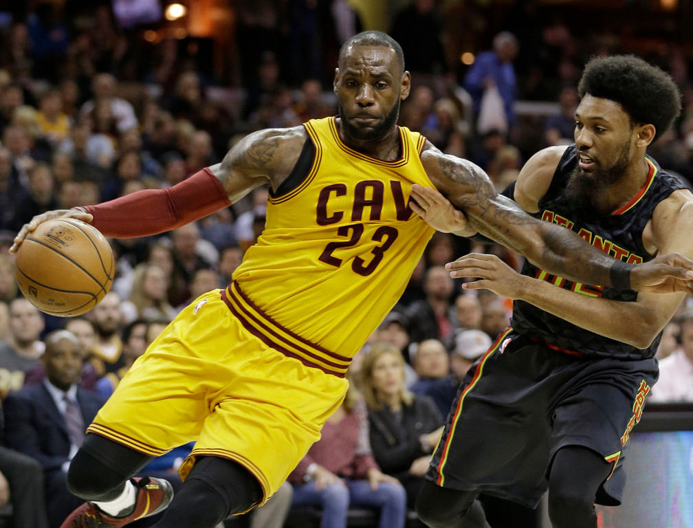. Cleveland Cavaliers\' LeBron James (23) drives past Atlanta Hawks\' DeAndre Bembry (95) in the second half of an NBA basketball game, Friday, April 7, 2017, in Cleveland. (AP Photo/Tony Dejak)