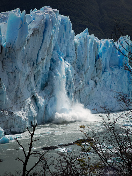 Iceberg calving off at Perrito Moreno glacier, in Patagonian Argentina.