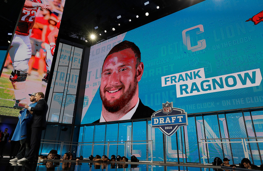 . Commissioner Roger Goodell, left, poses with a fan after the Detroit Lions selected Frank Ragnow during the first round of the NFL football draft, Thursday, April 26, 2018, in Arlington, Texas. (AP Photo/David J. Phillip)