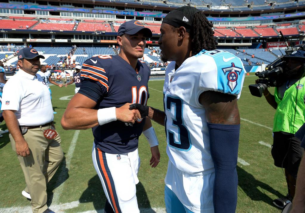 . Chicago Bears quarterback Mitchell Trubisky (10) greets Tennessee Titans cornerback Tye Smith (33) after an NFL football preseason game Sunday, Aug. 27, 2017, in Nashville, Tenn. The Bears won 19-7. (AP Photo/Mark Zaleski)