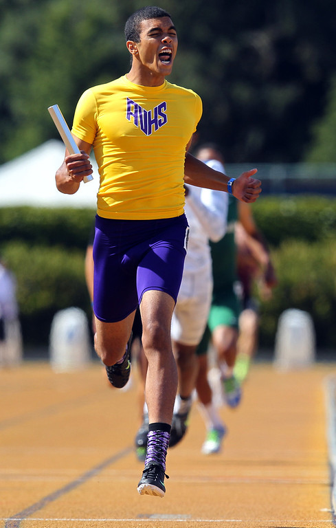 . Amador Valley\'s Darnell Roberson crosses the finish line first giving his team the win in the boys 4x400 meter relay final at the North Coast Section Meet of Champions at Cal\'s Edwards Stadium in Berkeley, Calif., on Saturday, May 25, 2013. (Anda Chu/Bay Area News Group)