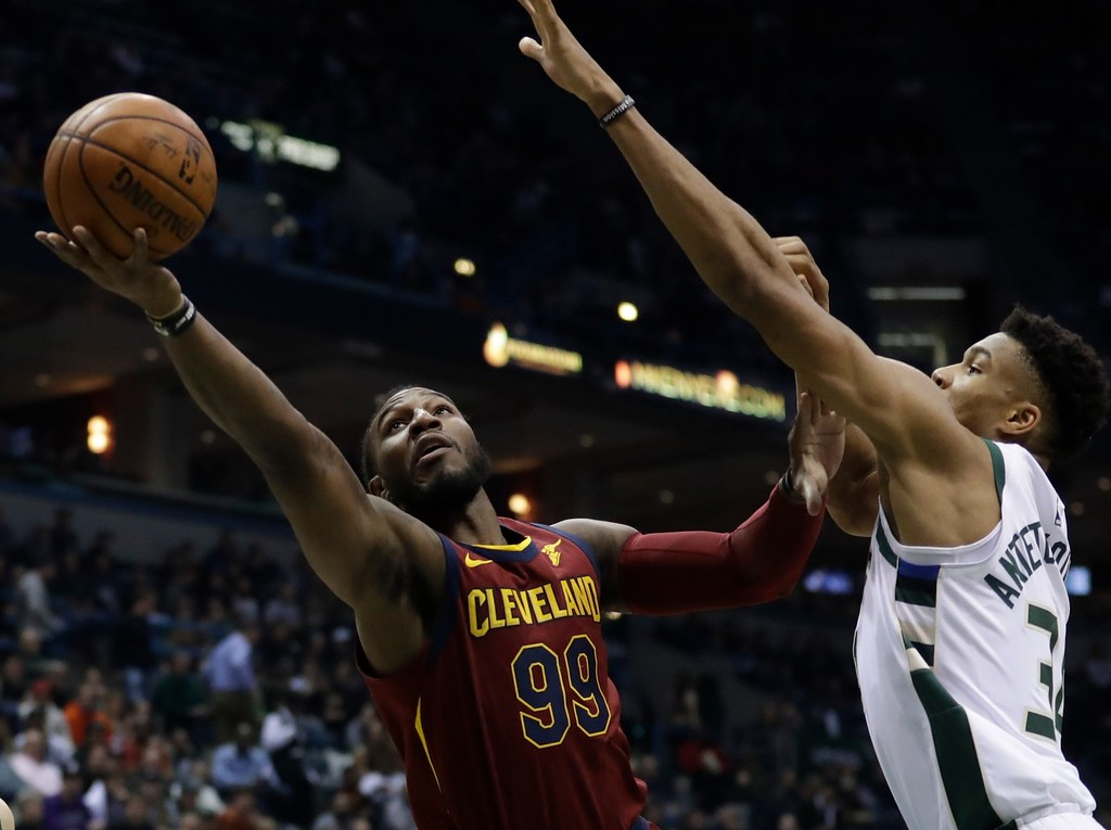 . Cleveland Cavaliers\' Jae Crowder shoots past Milwaukee Bucks\' Giannis Antetokounmpo during the first half of an NBA basketball game Tuesday, Dec. 19, 2017, in Milwaukee. (AP Photo/Morry Gash)