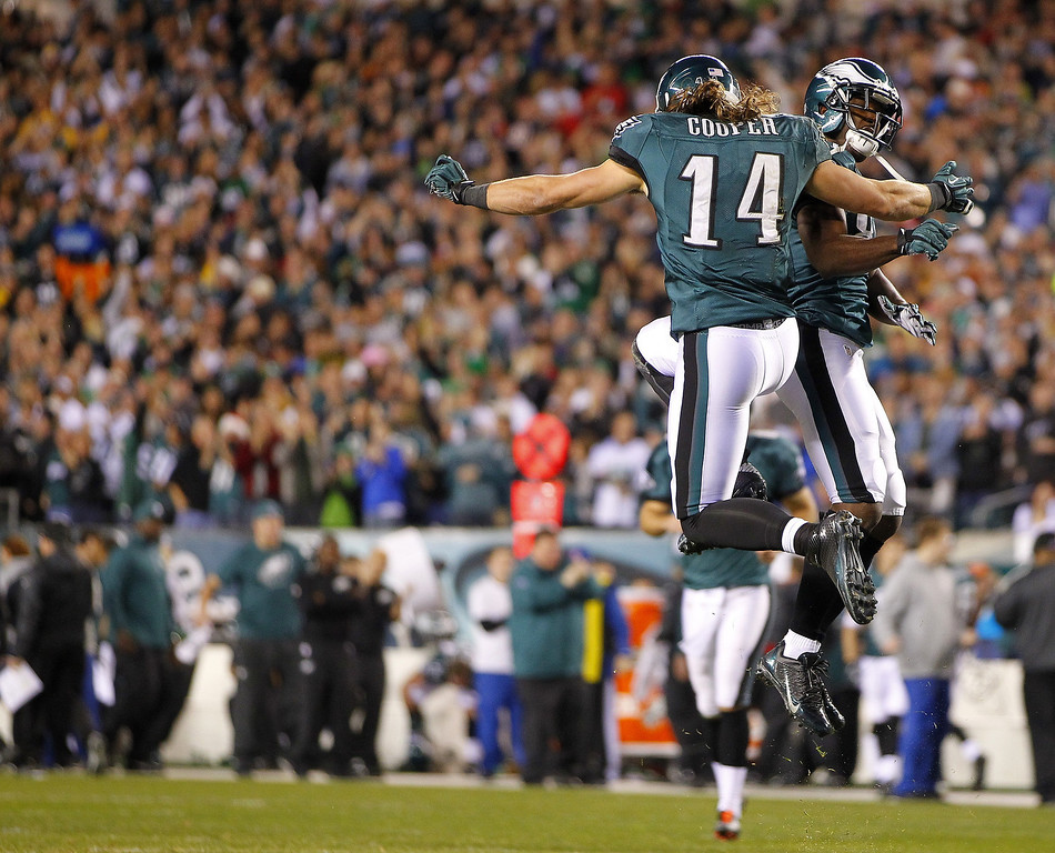 . Wide receiver Riley Cooper #14 of the Philadelphia Eagles celebrates with teammate Jason Avant #81after Cooper caught a pass for a touchdown against the Chicago Bears in the first quarter during a game at Lincoln Financial Field on December 22, 2013 in Philadelphia, Pennsylvania. (Photo by Rich Schultz /Getty Images)