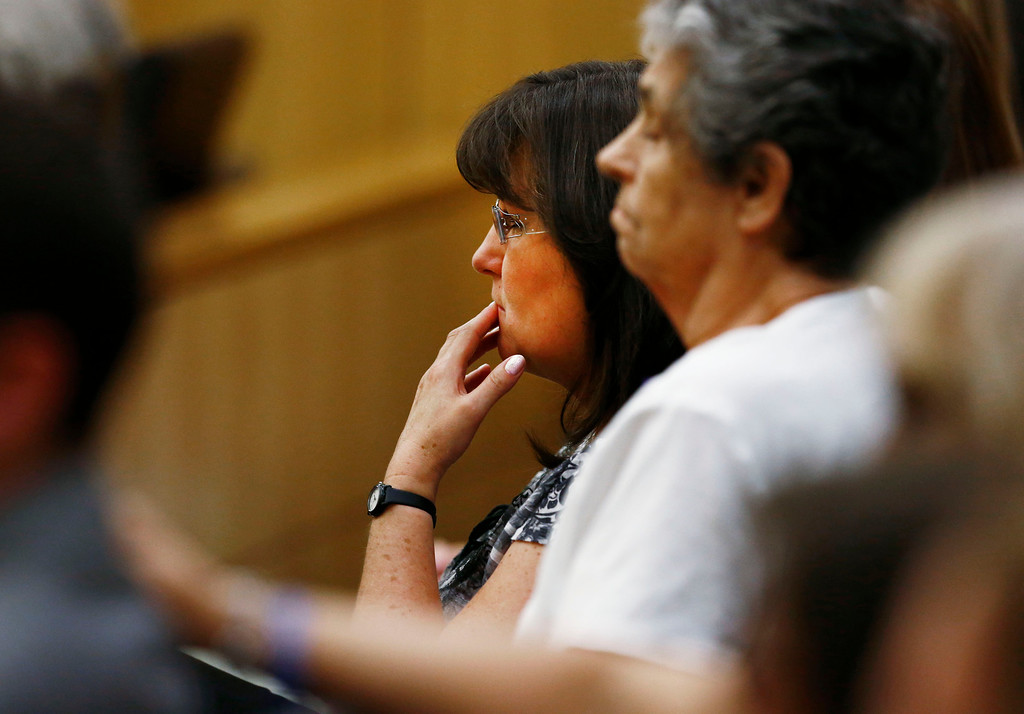 . Sandra Arias, center, reacts after her daughter, Jodi Arias, was found of guilty of first-degree murder in the gruesome killing her one-time boyfriend, Travis Alexander, in their suburban Phoenix home, Wednesday, May 8, 2013, at Maricopa County Superior Court in Phoenix.  (AP Photo/The Arizona Republic, Rob Schumacher, Pool)