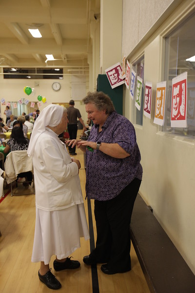 """Sr. Mary Gretna telling Sr. Antionette, """"It's okay to let him take a picture of you."""""""