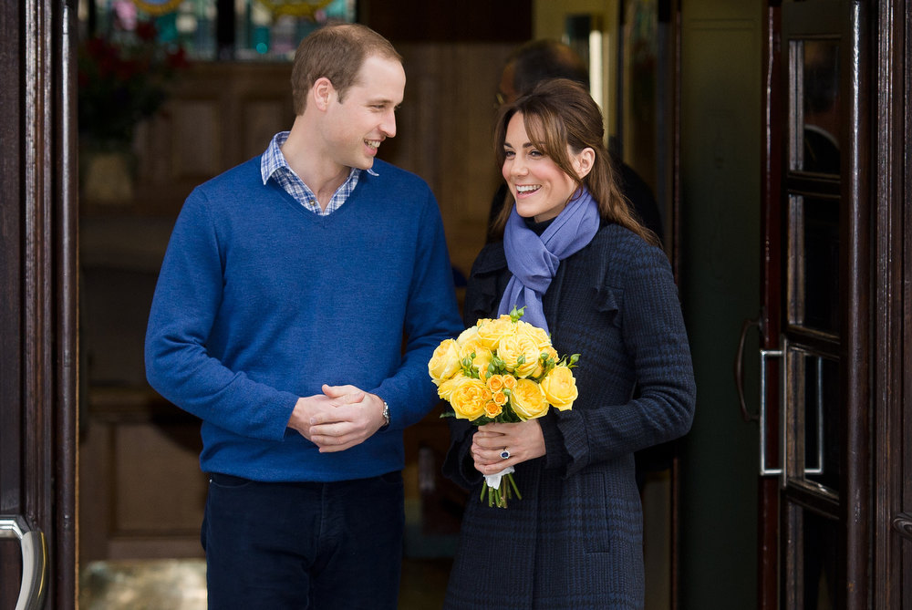 Description of . Britain's Prince WiIliam, the Duke of Cambridge, (L) poses for pictures with his wife Catherine, Duchess of Cambridge, as they leave the King Edward VII hospital in central London, on December 6, 2012. Prince William's pregnant wife Catherine left a London hospital on Thursday, four days after she was admitted for treatment for acute morning sickness. Kate Middleton ranked as Google's second most searched trending person of 2012. Her name ranked sixth in searches overall. LEON NEAL/AFP/Getty Images
