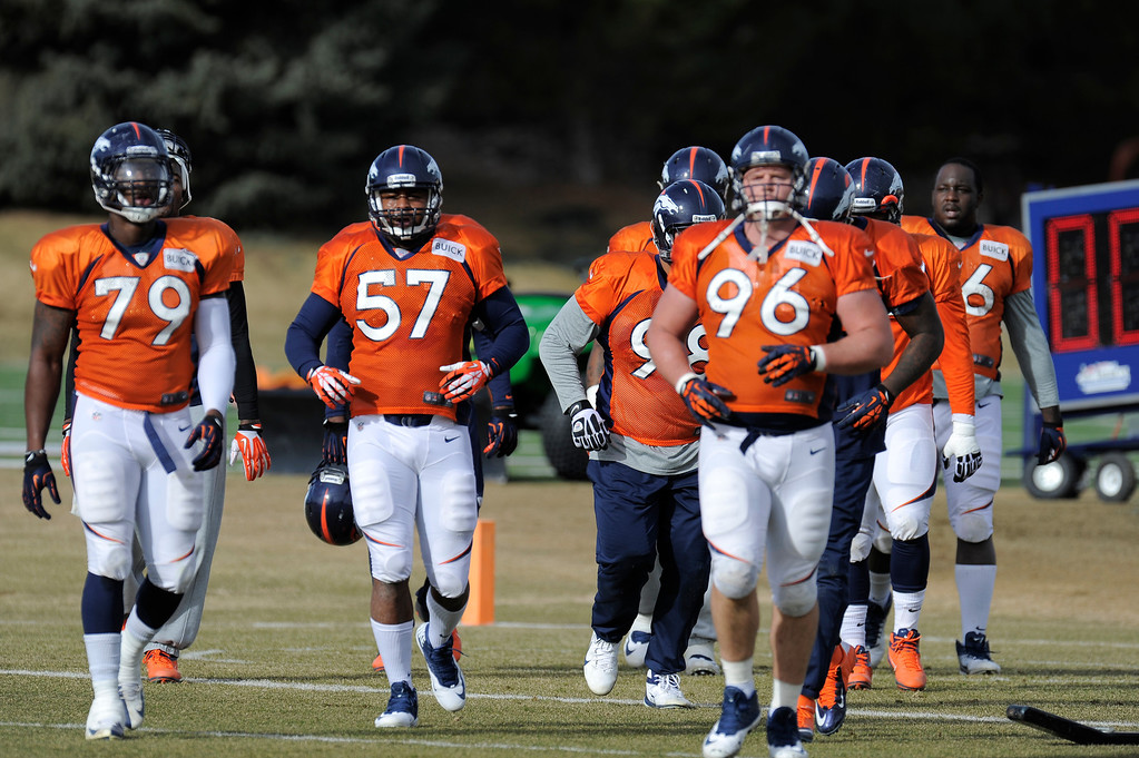 . Denver Broncos Jeremy Mincey (57) the newest player the Broncos signed jogs to the next drill during practice December 18, 2013 at Dove Valley (Photo by John Leyba/The Denver Post)