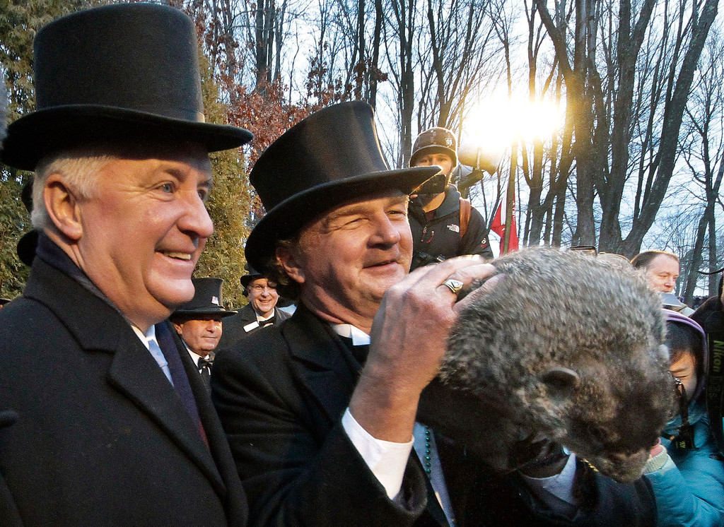 . Groundhog Club handler John Griffiths, right, holds Punxsutawney Phil, the weather prognosticating groundhog, for pictures with Pennsylvania Governor Tom Corbett, during the 126th celebration of Groundhog Day on Gobbler\'s Knob in Punxsutawney, Pa. Thursday, Feb. 2, 2012. Phil saw his shadow, forecasting six more weeks of winter weather. (AP Photo/Gene J. Puskar)