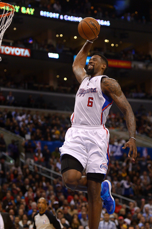 . The Clippers\' DeAndre Jordan grins during a breakaway dunk against the Lakers in the first half, Friday, January 10, 2014, at Staples Center. (Photo by Michael Owen Baker/L.A. Daily News)