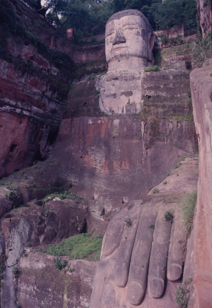 Giant Sitting Buddha of Leshan; the largest stone Buddha in the world. A likeness of Maitreya, it was built in 90 yrs. from 713 to 803 A.D. and sits near where 3 rivers meet.