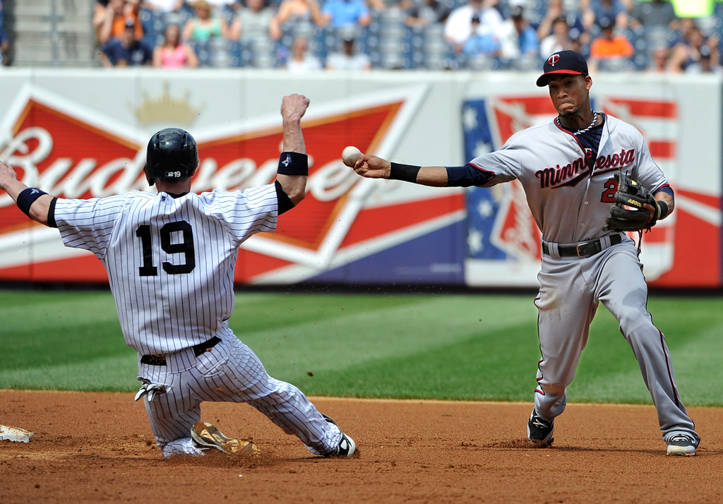 . New York\'s Chris Stewart, left, is forced out at second base by Twins shortstop Pedro Florimon, right, in the fourth inning. The throw to first base was not in time to double off Ichiro Suzuki at first base. (AP Photo/Kathy Kmonicek)