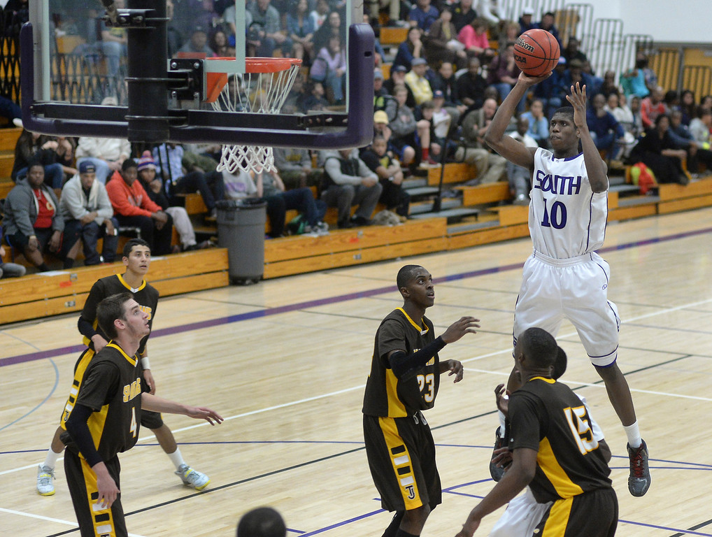 . Rebels\' senior Ibrahim Sylla (10) released a jump shot late in the fourth quarter.   Photo By Karl Gehring/The Denver Post