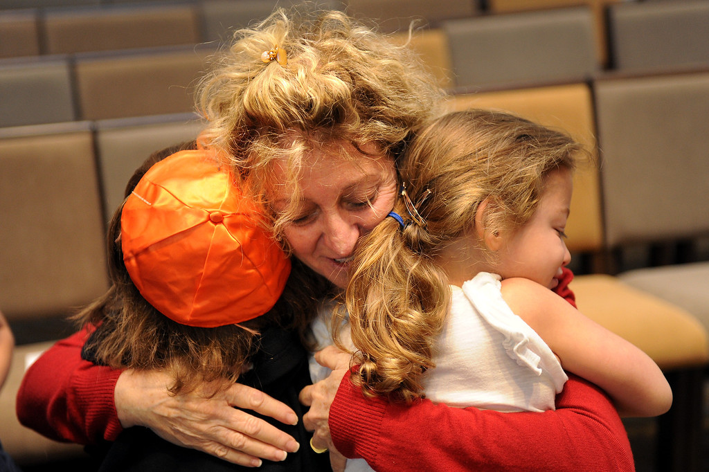 . School children hug Beth Hillel Day School teacher Mickey Rabinov after she was surprised with a $15,000 award from the Milken Family Foundation at the Valley Village School, Tuesday, October 15, 2013. (Photo by Michael Owen Baker/L.A. Daily News)