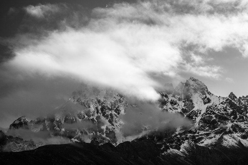 Black and white photo of Himalayan Mountains hidden in clouds, Nepal