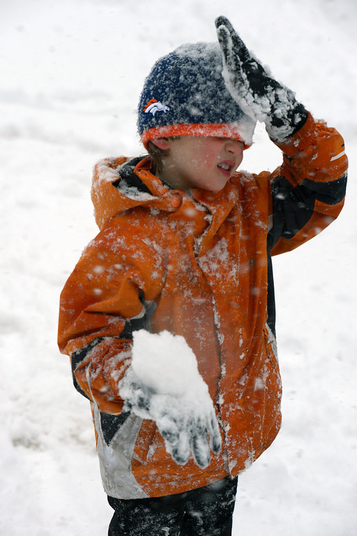 . BOULDER, CO- FEBRUARY 19:  Alexander Waters, 6, is covered in snow as he plays with his cousin in Washington Park on February 20, 2013.  Snow hit the Denver metro area around 2:30 with forecasters calling for  2-4 inches in Denver more to the South and East.  (Photo By Helen H. Richardson/ The Denver Post)