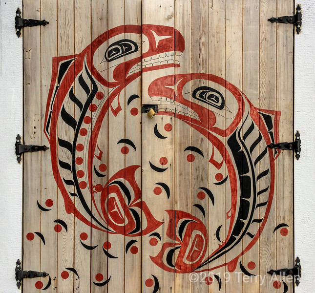 Door with Giga'at salmon design, Hartley Bay sallmon hatchery, Hartley Bay, British Columbia.jpg
