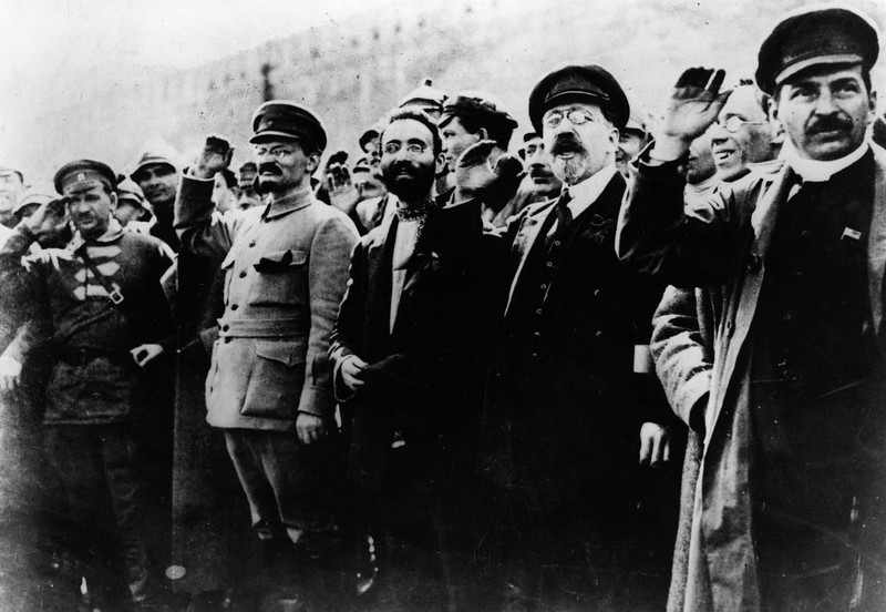 . Communist leaders including Joseph Stalin and Leon Trotsky seen saluting in the street during the Russian Revolution.   (Photo by Keystone/Getty Images)
