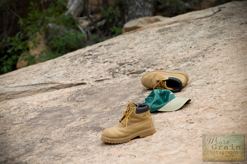 """This shot was Ash's idea.  It's the shoes and hat he shed after a full day of hiking adventures in Zion National Park.  He said we should call this photo """"Done!""""  :)"""