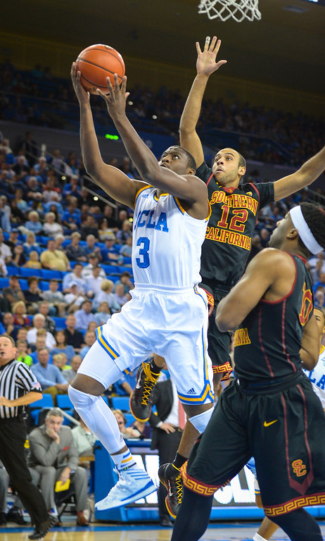 . UCLA�s Jordan Adams goes up for two points as USC�s Julian Jacobs defends on the play during game action at Pauley Pavilion Sunday, December 5, 2014. UCLA  defeated USC 107-73.  Photo by David Crane/Los Angeles Daily News.