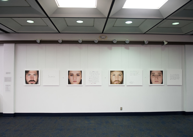 """The second floor of the Mary and Jeff Bell Library features the Bachelor of Fine Arts (BFA) exhibition, """"LOOKING,"""" created by Islander student Robert T. Neal."""