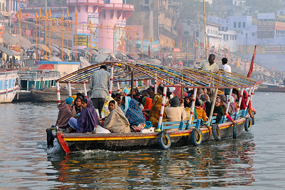 Pilgrims on a morning boat ride in Varansi, India.