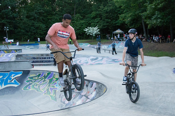 06/21/19 Wesley Bunnell | Staff New Britain held a grand opening for its Stanley Quarter Park Skate Park on Friday June 21, 2019. Javier Irizarry, L, performs a trick.