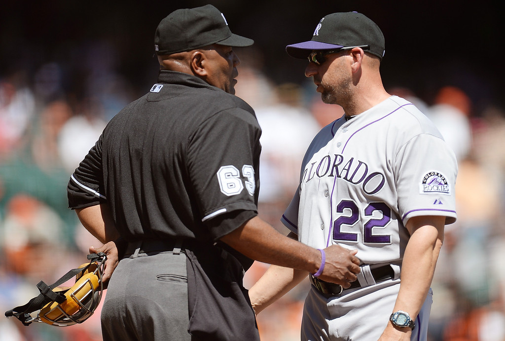 . SAN FRANCISCO, CA - APRIL 10: Manager Walt Weiss #22 of the Colorado Rockies argues with home plate umpire Laz Diaz #63 over a called strike three on Troy Tulowitzki #2 against the San Francisco Giants in the first inning at AT&T Park on April 10, 2013 in San Francisco, California. (Photo by Thearon W. Henderson/Getty Images)