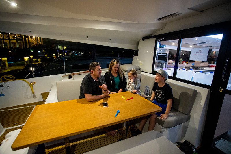The cockpit also has a large table that can easily seat 8 people around it.  Rob and the family in an intense game of spoons while we are in the Scrub Island Marina.