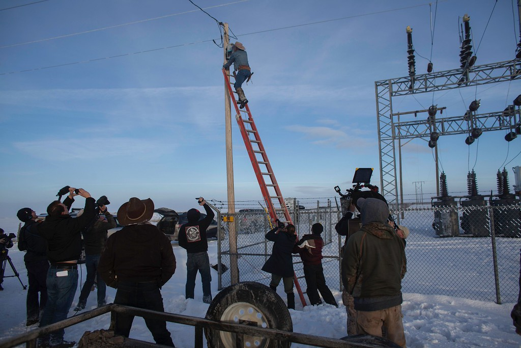 . LaVoi Finicum removes Canon lenses from a power pole remote camera location near the occupied Malheur National Wildlife Refuge Headquarters in Burns, Oregon on January 15, 2016. The armed group that began a protest two weeks ago by occupying the buildings on the federal wildlife preservation. The act of removing the cameras was a communication to the FBI who have presumably been observing the groups\' behavior.   / AFP / Rob KerrROB KERR/AFP/Getty Images