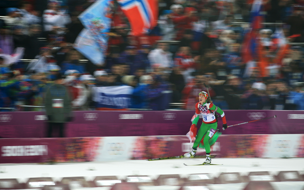 . Darya Domracheva of Belarus celebrates winning the Women\'s 10 km Pursuit during day four of the Sochi 2014 Winter Olympics at Laura Cross-country Ski & Biathlon Center on February 11, 2014 in Sochi, Russia.  (Photo by Richard Heathcote/Getty Images)