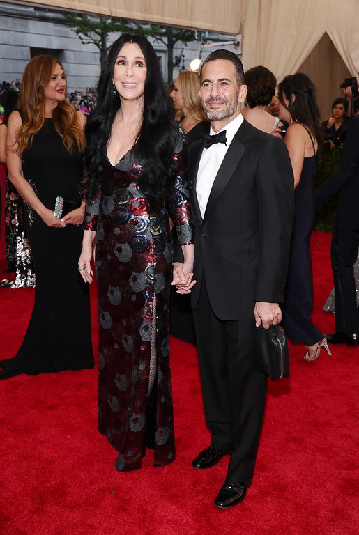 """. Cher, left, and Marc Jacobs arrive at The Metropolitan Museum of Art\'s Costume Institute benefit gala celebrating \""""China: Through the Looking Glass\"""" on Monday, May 4, 2015, in New York. (Photo by Charles Sykes/Invision/AP)"""