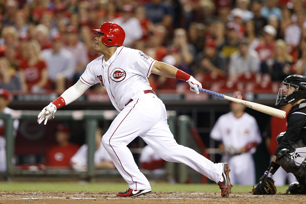 . CINCINNATI, OH - MAY 9: Brayan Pena #29 of the Cincinnati Reds hits a sacrifice fly to drive in a run in the bottom of the eighth inning of the game against the Colorado Rockies at Great American Ball Park on May 9, 2014 in Cincinnati, Ohio. The Reds won 4-3. (Photo by Joe Robbins/Getty Images)