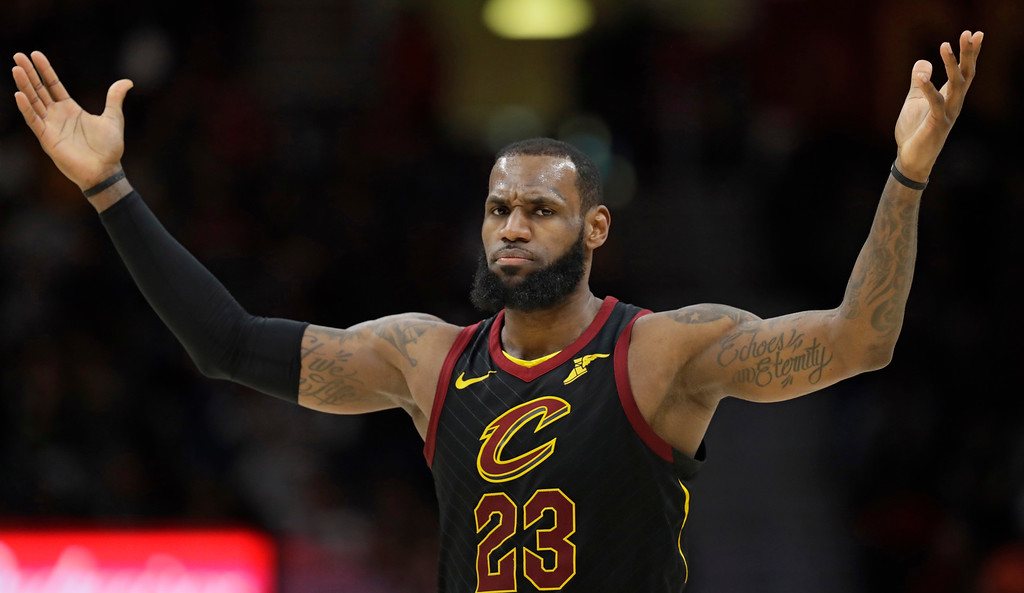 . Cleveland Cavaliers\' LeBron James reacts in the second half of an NBA basketball game against the Milwaukee Bucks, Monday, March 19, 2018, in Cleveland. (AP Photo/Tony Dejak)